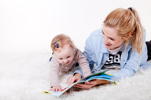 encourage children to read mother reading to baby